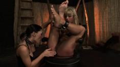 Naughty young bimbo Sandra gets tied up by a sensual mistress