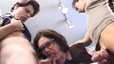 Lustful granny with big breasts has two young guys sharing her pussy