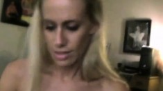 Busty blonde doing titjob and blowjob at same time